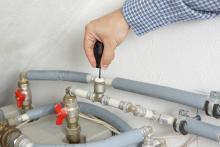 Technician repairing heating system