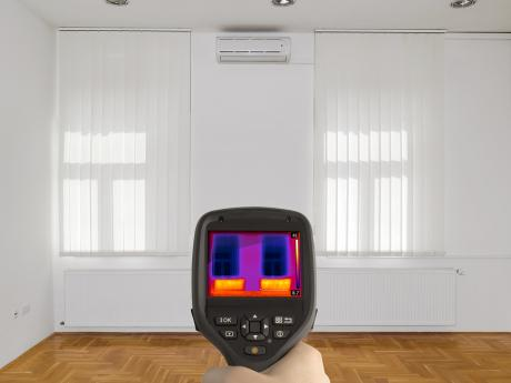 Thermal imaging of bare room with white walls and wooden flooring