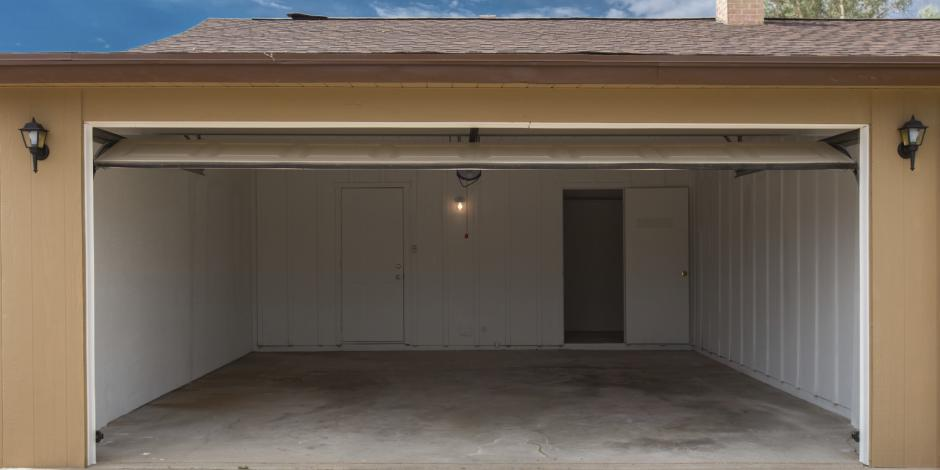 Attached garage with an open door.