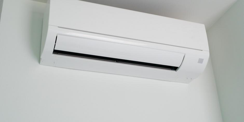 ductless mini split on white wall