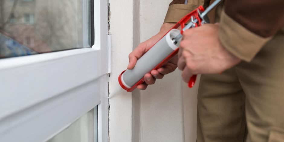 Air sealing home with window caulking